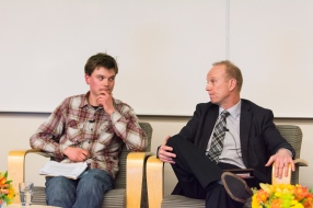 Divest UVic representative Malkolm Boothroyd (left) and Suncor VP Investor Relations Steve Douglas share a moment at a UVic forum on fossil fuel divestment in January 2015.