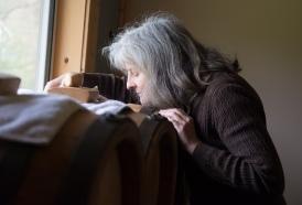 Vintner and vinegar producer Marilyn Schulze takes in the smell of balsalmic vinegar at her family's farm.