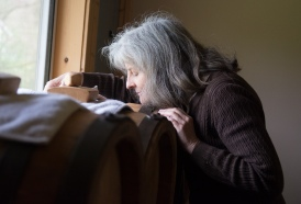 Vintner and vinegar producer Marilyn Schulze takes in the smell of balsalmic vinegar at her family's farm.