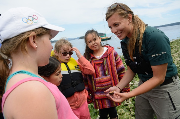 Clam garden project co-ordinator Skye Augustine shows a limpet to students.