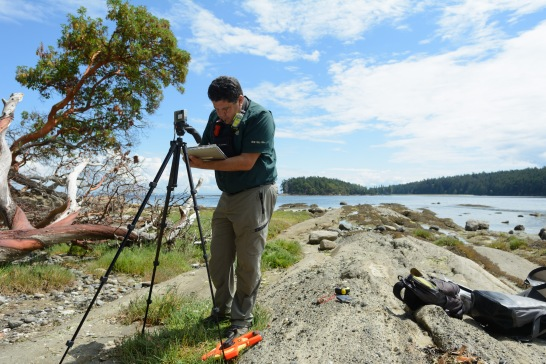 David Dick is measuring erosion on Cabbage Island as part of cultural site monitoring.