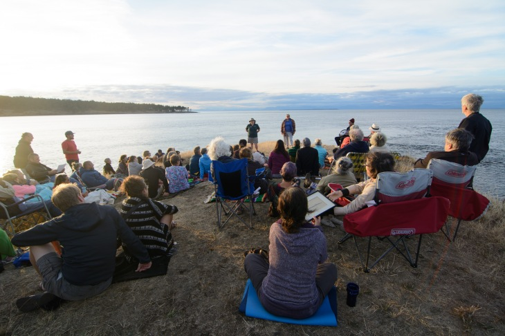 Parks interpreter Athena George leads a sunset program at East Point on Saturna Island, featuring local musicians, storytellers, and park news.