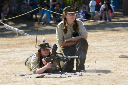 Two interpreters at Fort Rodd Hill and Fisgard Lighthouse demonstrate a Bren light machine gun during a Fab Forts event.